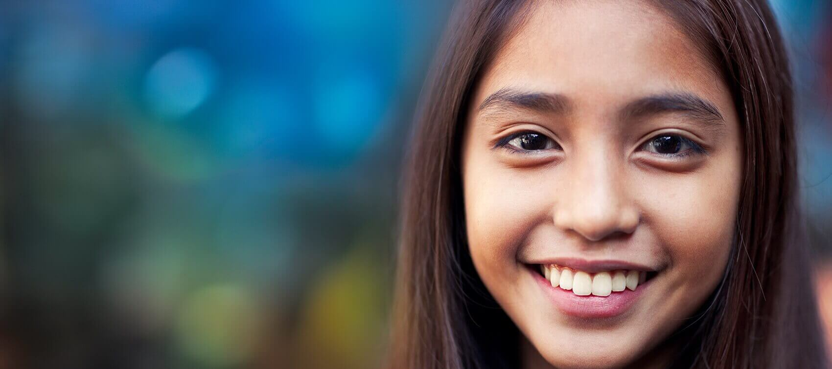 young girl with a bright, white smile
