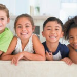 Group of children smiling after they visit their pediatric dentist in San Antonio, TX